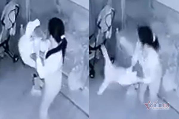 Tạm giữ nữ giúp việc dốc ngược bé gái, cầm chân quay như chong chóng